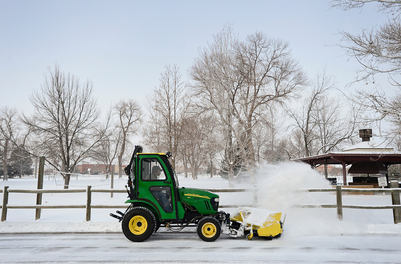 Keith Parrinello plows snow from roads, Thursday, Feb. 21, 2013, around the Boulder County Fairgrounds.<br /> (Matthew Jonas/Times-Call)