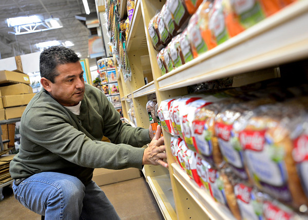 """Randy Magana, with Alpine Valley Bread, stocks shelves at the new Sprouts location, 1101 S. Hover St., in Longmont on Monday, Dec. 31, 2012. For more photos and a video visit  <a href=""""http://www.TimesCall.com"""">http://www.TimesCall.com</a>.<br /> (Greg Lindstrom/Times-Call)"""