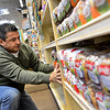 "Randy Magana, with Alpine Valley Bread, stocks shelves at the new Sprouts location, 1101 S. Hover St., in Longmont on Monday, Dec. 31, 2012. For more photos and a video visit  <a href=""http://www.TimesCall.com"">http://www.TimesCall.com</a>.<br /> (Greg Lindstrom/Times-Call)"