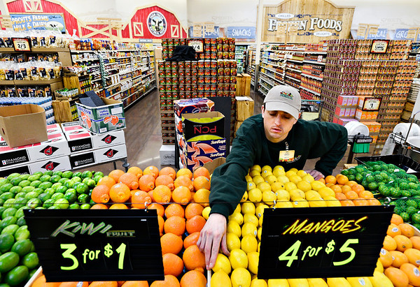 "Billy Abplanalp stocks produce at the new Sprouts location, 1101 S. Hover St., in Longmont on Monday, Dec. 31, 2012. For more photos and a video visit  <a href=""http://www.TimesCall.com"">http://www.TimesCall.com</a>.<br /> (Greg Lindstrom/Times-Call)"