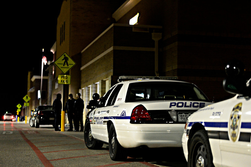 20130122_WALMART_0002.jpg Police investigate the parking lot at Walmart in north Longmont on Tuesday, Jan. 22, 2013.<br /> (Greg Lindstrom/Times-Call)