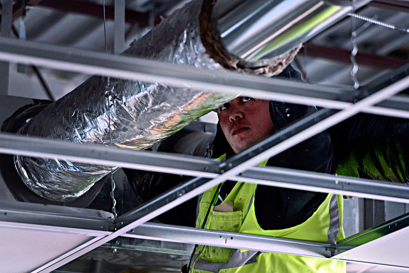 Michael Gonzales, with Mechanical Insulation Systems, Inc., installs duct insulation in a future classroom at Thunder Valley K-8 School in Frederick on Thursday, Dec. 27, 2012.<br /> (Greg Lindstrom/Times-Call)