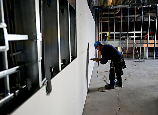 Joel Raza, with Phase II Construction, installs new drywall at Thunder Valley K-8 School in Frederick on Thursday, Dec. 27, 2012.<br /> (Greg Lindstrom/Times-Call)