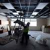 Michael Gonzales, with Mechanical Insulation Systems, Inc., moves a ladder while working on duct insulation in a future classroom at Thunder Valley K-8 School in Frederick on Thursday, Dec. 27, 2012.<br /> (Greg Lindstrom/Times-Call)