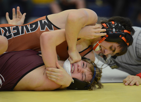 Mead's Sage Budd gets his fist into the face of Berthoud's Matthew Bonds in their 113 pound match during the Tri Valley League wrestling tournament Saturday Feb. 02, 2013 at Frederick High School. (Lewis Geyer/Times-Call)