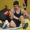 Frederick's Dylan Shoop and Erie's Jacob Schadler wrestle in a 138 pound match during the Tri Valley League wrestling tournament Saturday Feb. 02, 2013 at Frederick High School. (Lewis Geyer/Times-Call)