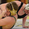 Erie's Ladd Bunker gets ahold of Frederick's Noah Payne in their 160 pound match during the Tri Valley League wrestling tournament Saturday Feb. 02, 2013 at Frederick High School. (Lewis Geyer/Times-Call)