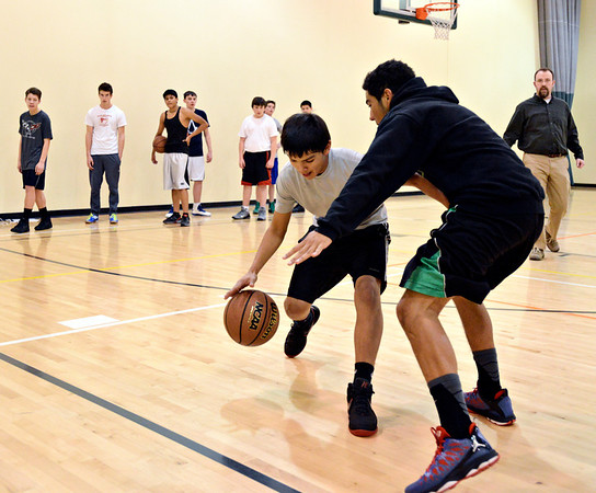"Bobby Alteaga tries to dribble around Alex Heredia during basketball practice at Twin Peaks Charter Academy on Friday, Jan. 4, 2013. For more photos visit  <a href=""http://www.BoCoPreps.com"">http://www.BoCoPreps.com</a>.<br /> (Greg Lindstrom/Times-Call)"