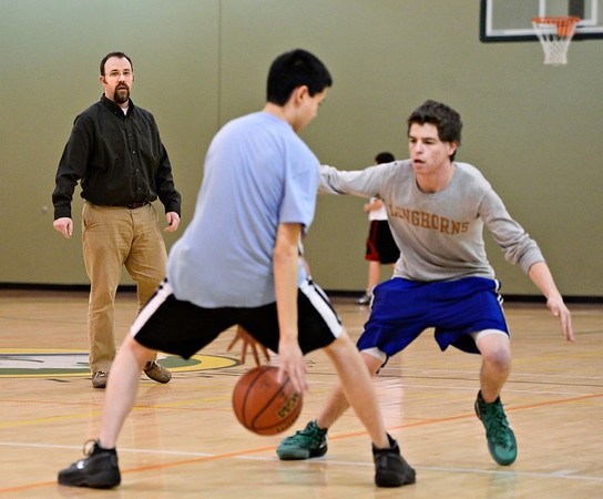 """Head coach Elliott Loftis watches his players during a drill at basketball practice at Twin Peaks Charter Academy on Friday, Jan. 4, 2013. For more photos visit  <a href=""""http://www.BoCoPreps.com"""">http://www.BoCoPreps.com</a>.<br /> (Greg Lindstrom/Times-Call)"""