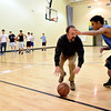 """Head coach Elliott Loftis demonstrates a drill with Gabe Grant, right, during basketball practice at Twin Peaks Charter Academy on Friday, Jan. 4, 2013. For more photos visit  <a href=""""http://www.BoCoPreps.com"""">http://www.BoCoPreps.com</a>.<br /> (Greg Lindstrom/Times-Call)"""