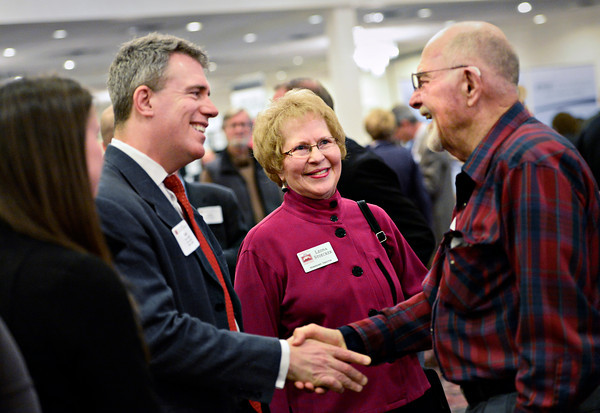 "Bill Shirley, right, with the Longmont Community Foundation, greets Scott Gessler, left, Colorado Secretary of State, as former Longmont Mayor Leona Stoecker, center, looks on during the annual Unity in the Community event, hosted by the Longmont Area Chamber of Commerce, at the Plaza Conference Center in Longmont on Thursday, Feb. 28, 2013. For more photos visit  <a href=""http://www.TimesCall.com"">http://www.TimesCall.com</a>.<br /> (Greg Lindstrom/Times-Call)"