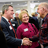 """Bill Shirley, right, with the Longmont Community Foundation, greets Scott Gessler, left, Colorado Secretary of State, as former Longmont Mayor Leona Stoecker, center, looks on during the annual Unity in the Community event, hosted by the Longmont Area Chamber of Commerce, at the Plaza Conference Center in Longmont on Thursday, Feb. 28, 2013. For more photos visit  <a href=""""http://www.TimesCall.com"""">http://www.TimesCall.com</a>.<br /> (Greg Lindstrom/Times-Call)"""