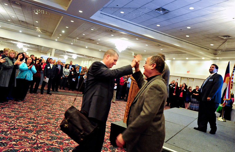 """Forrest Fleming, Longmont Area Chamber of Commerce board chairman, right, greets Longmont Councilman Brian Bagley during a presentation at the annual Unity in the Community event, hosted by the Longmont Area Chamber of Commerce, at the Plaza Conference Center in Longmont on Thursday, Feb. 28, 2013. For more photos visit  <a href=""""http://www.TimesCall.com"""">http://www.TimesCall.com</a>.<br /> (Greg Lindstrom/Times-Call)"""