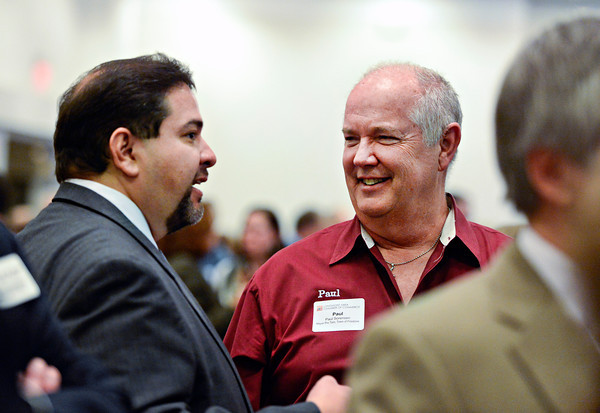 "Firestone Mayor Pro-tem Paul Sorensen, right, chats with Longmont City Councilman Gabe Santos during the annual Unity in the Community event, hosted by the Longmont Area Chamber of Commerce, at the Plaza Conference Center in Longmont on Thursday, Feb. 28, 2013. For more photos visit  <a href=""http://www.TimesCall.com"">http://www.TimesCall.com</a>.<br /> (Greg Lindstrom/Times-Call)"