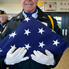 Veteran and American Legion Longmont Post 32 Honor Guard member Darrell Anderson holds the flag before a ceremony to honor veterans, Monday, Nov. 12, 2012, at Longs Peak Middle School.<br /> (Matthew Jonas/Times-Call)