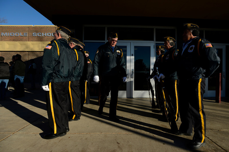American Legion Longmont Post 32 members stand at attention during a ceremony to honor veterans, Monday, Nov. 12, 2012, at Longs Peak Middle School.<br /> (Matthew Jonas/Times-Call)