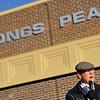 Bruce Bennett speaks during a ceremony to honor veterans, Monday, Nov. 12, 2012, at Longs Peak Middle School.<br /> (Matthew Jonas/Times-Call)
