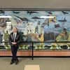 Bruce Bennett stands next to a veterans memorial mural after a ceremony to honor veterans was held, Monday, Nov. 12, 2012, at Longs Peak Middle School. Bennett was an art teacher at Longs Peak from 1973 to 2004 and was partly responsible for the mural. <br /> (Matthew Jonas/Times-Call)