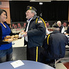 From left: Abigail Arriaga shares a laugh with veteran U.S. Air Force E7 Master Sgt. Phil Williams before a ceremony to honor veterans, Monday, Nov. 12, 2012, at Longs Peak Middle School. Williams served during the Vietnam War.<br /> (Matthew Jonas/Times-Call)