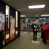 From left: Debbie Anderson, mother of Christopher Anderson, talks with U.S. Navy veteran Marilyn Miyazima while standing in the hall near the veterans memorial mural after a ceremony to honor veterans, Monday, Nov. 12, 2012, at Longs Peak Middle School.<br /> (Matthew Jonas/Times-Call)