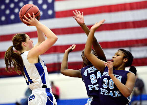 """Longmont's Madi Gaibler (21) shoots over Vista PEAK's Aaliyah Carter (24) and Jaylynn Johnson (30) during the game at Longmont High School on Tuesday, Feb. 26, 2013. Longmont beat Vista PEAK 65-18. For more photos visit  <a href=""""http://www.BoCoPreps.com"""">http://www.BoCoPreps.com</a>.<br /> (Greg Lindstrom/Times-Call)"""