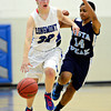 "Longmont's Megan Tulenko (32) drives past Vista PEAK's Malia Kennedy (14) during the game at Longmont High School on Tuesday, Feb. 26, 2013. Longmont beat Vista PEAK 65-18. For more photos visit  <a href=""http://www.BoCoPreps.com"">http://www.BoCoPreps.com</a>.<br /> (Greg Lindstrom/Times-Call)"