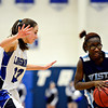 """Longmont's Kathryn Schell (23) pressures Vista PEAK's Aaliyah Carter during the game at Longmont High School on Tuesday, Feb. 26, 2013. Longmont beat Vista PEAK 65-18. For more photos visit  <a href=""""http://www.BoCoPreps.com"""">http://www.BoCoPreps.com</a>.<br /> (Greg Lindstrom/Times-Call)"""