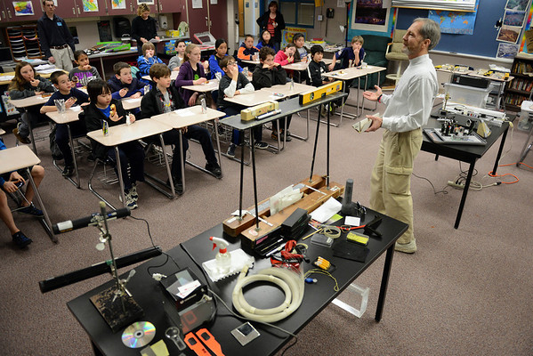 CU Science Discovery instructor Fred Gluck talks about the science of light during a light and laser physics demonstration Wednesday March 6, 2013 at Westview Middle School. (Lewis Geyer/Times-Call)