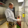 Electrician Dan Feiner with Feiner Electric measures the spce for a refrigerator at the new Ziggi's Coffee House at 104th Ave. and Federal Blvd. in Westminster on Thursday.<br /> February 14, 2013<br /> staff photo/ David R. Jennings