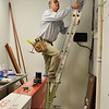 Electrician Dan Feiner with Feiner Electric climbs a ladder to work on the electric of the new Ziggi's Coffee House at 104th Ave. and Federal Blvd. in Westminster on Thursday.<br /> February 14, 2013<br /> staff photo/ David R. Jennings