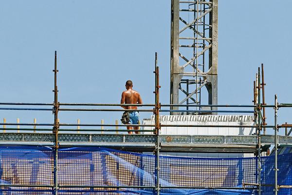 Construction worker. Building progress ne146d.