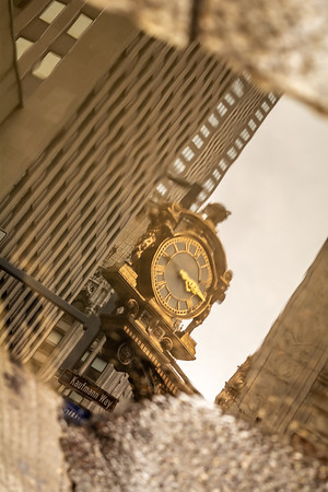 Gold Clock Reflecting Time