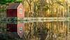 red barn on lake