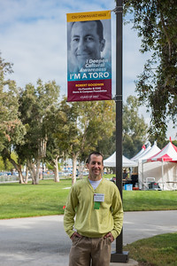 Alumni Robert Goodwin poses in front of his I'm a toro banner at CSUDH in April 2017