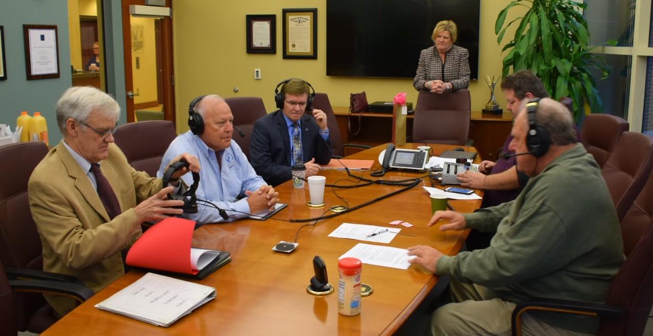 Seated around the table are (l to r): Kent Massie, Gary Clayton, Springfield Mayor Jim Langfelder, Shawn Balint and Sam Madonia.