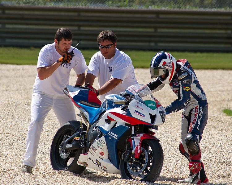 AMA Pro SuperSport racer Raphael Archambault getting some help after crashing his Honda at Barber Motorsports Park.