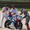 AMA Pro SuperSport racer Raphael Archambault getting some help after crashing his Honda at Barber Motorsports Park.