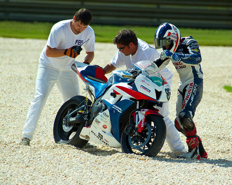 AMA Pro SuperSport racer Raphael Archambault in the sand trap with his Honda at Barber Motorsports Park.