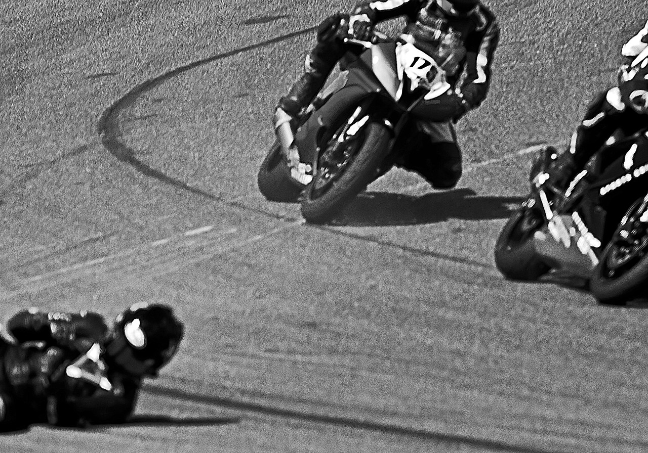 I believe that is Corey West sliding down the track sans motorcycle during crash at Barber Motorsports Parks during 2010 AMA Championships.  Rider Sam Rozynski passes in background.