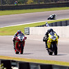 Dellinger, O'Hara, and Kerr race down front stretch at Barber Motorsports Park.