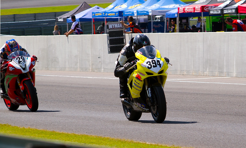 Dellinger, and O'Hara race down front stretch at Barber Motorsports Park.