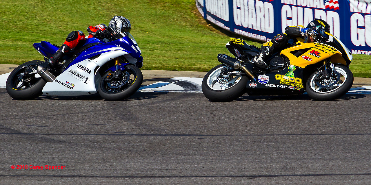 Professional motorcycle racers Eslick and Seller doing battle on the track.