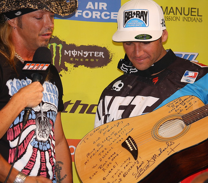 Chad Reed reads note on Bret Michaels signed guitar as Chas receives first ever Rock Hard Ride Hard Award