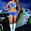 Falken Tire Girl Posing with Vaughn Gitten Jr Falken Tires Monster Energy Drift Car
