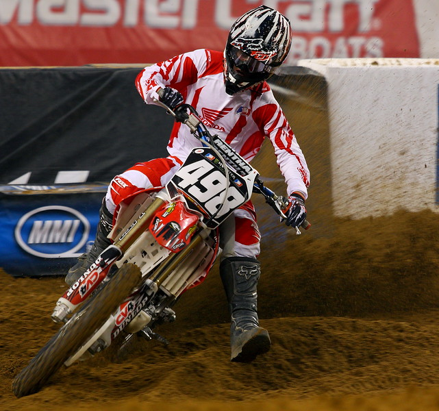 AMA SX Lites Cody Robbins Kicks up a Rooster Tail of Dirt in Cowboys Stadium