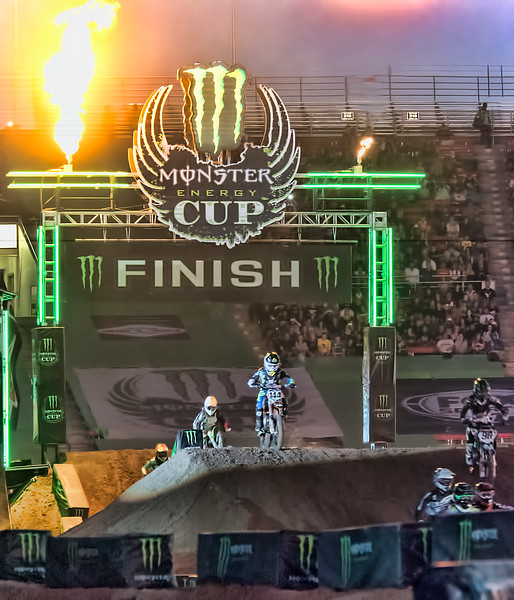 Monster Energy Cup opening ceremony flames flying crowd cheering as racers round the track at Sam Boyd