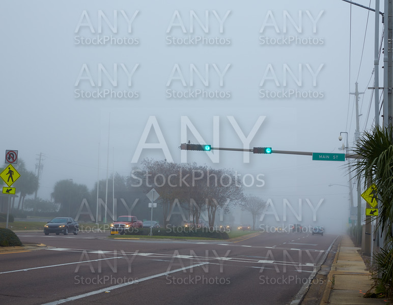 Foggy haze morning in Florida with traffic cars