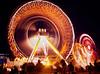 Light trails from amusement park rides