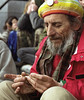 Elderly man rolling a joint