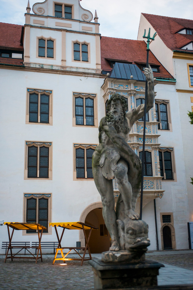 Statue in Hartenfels Castle courtyard.